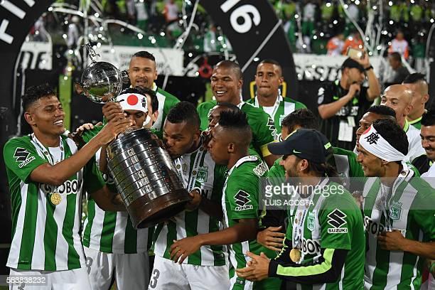 Colombia's Atletico Nacional Miguel Borja kisses the trophy after winning the 2016 Copa Libertadores at Atanasio Girardot stadium in Medellin...