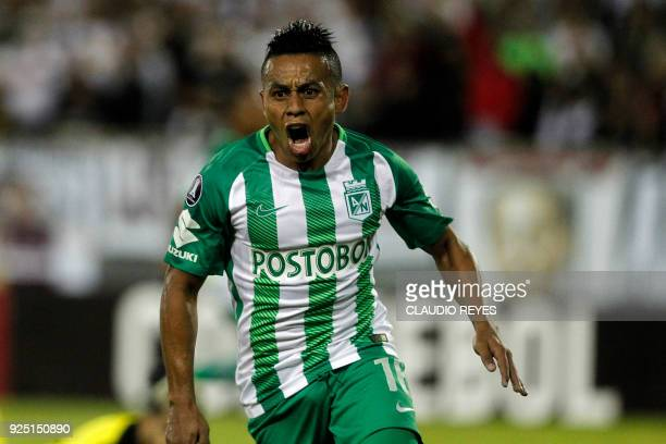 Colombia's Atletico Nacional player Vladimir Hernandez celebrate after scoring a goal against Chile's ColoColo during their Copa Libertadores...
