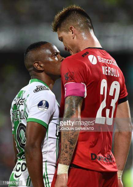 Colombia's Atletico Nacional player Yerson Candelo argues with Argentina's Huracan player Lucas Merolla during their Copa Sudamericana football match...