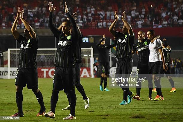 Colombia's Atletico Nacional players celebrate after defeating Brazil's Sao Paulo in their 2016 Copa Libertadores semi final first leg football match...