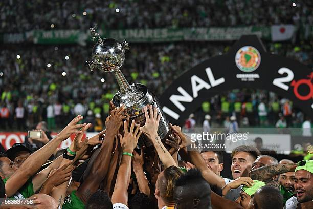 Colombia's Atletico Nacional players hold up the trophy after winning the 2016 Copa Libertadores at Atanasio Girardot stadium in Medellin Antioquia...