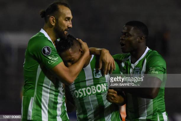 Colombia's Atletico Nacional Sebastian Gomez celebrates with his teammates Carlos Augusto Rivas and Hernan Barcos after scoring against Venezuela's...