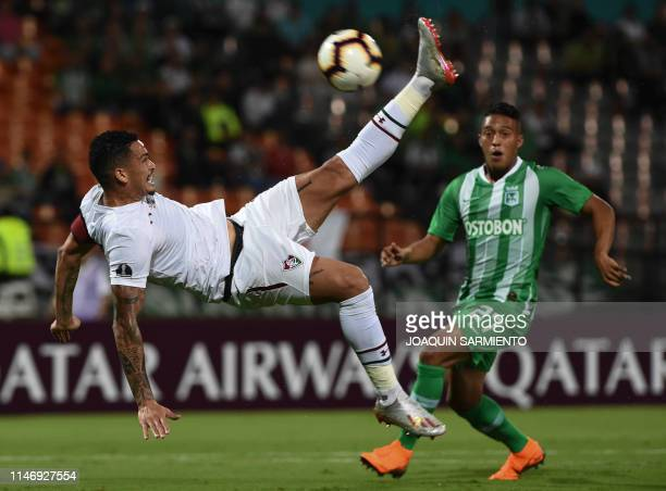 Colombia's Atletico Nacional Sebastian Gomez vies for the ball with Brazil's Fluminense Marcos Felipe during their Copa Sudamericana football match...