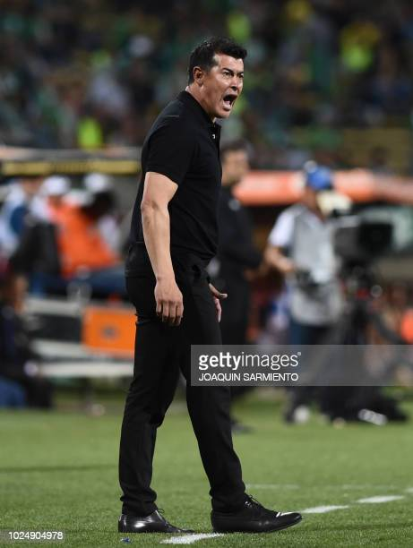 Colombia's Atletico Nacional team coach Jorge Almiron gestures during their Copa Libertadores football match against Argentina's Atletico Tucuman at...