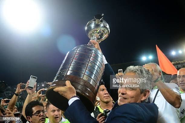 Colombia's Atletico Nacional's coach Reinaldo Rueda holds up teh trophy after winning the Libertadores Cup at the Atanasio Girardot stadium in...
