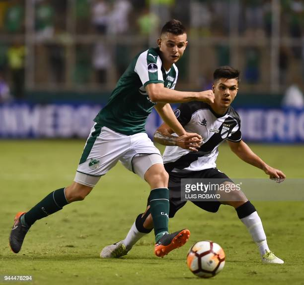 Colombia's Cali player Nicolas Benedetti vies for the ball with Uruguay's Danubio Rodrigo Fernandez during their Copa Sudamericana football match in...