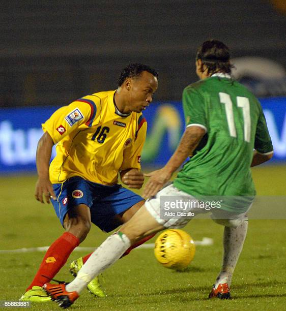 Colombia's Camilo Zuniga clears the ball away from Bolivia's Pablo Escobar during their World Cup 2010 qualifying soccer match on March 28 2009 in...