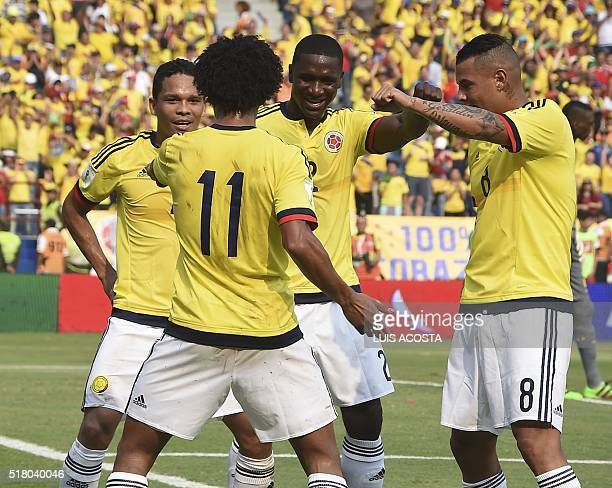 Colombia's Carlos Bacca celebrates with teammates after scoring against Ecuador during their Russia 2018 FIFA World Cup South American Qualifiers'...