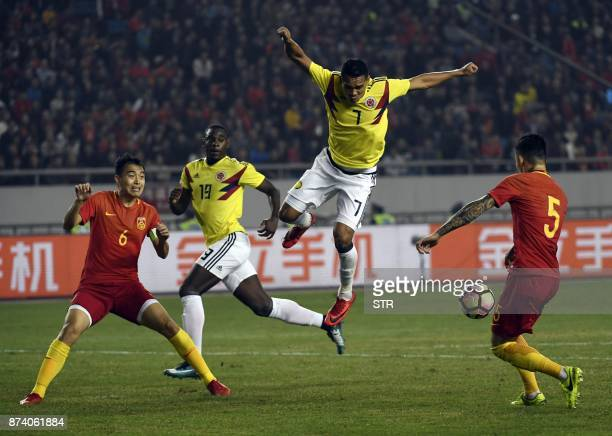 Colombia's Carlos Bacca fights for the ball with China's Zhang Linpeng during their international friendly football match in Chongqing southwest...