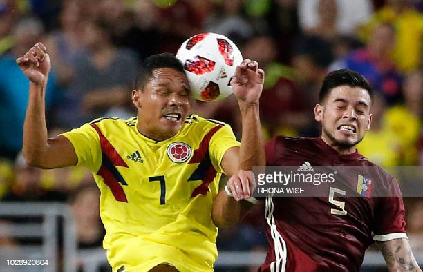 Colombia's Carlos Bacca heads the ball next to Venezuela's Junior Moreno during the international friendly football match between Colombia and...