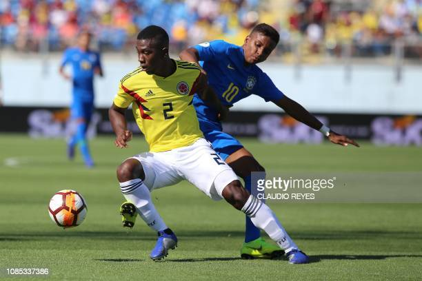 Colombia's Carlos Cuesta vies for the ball with Brazil's Rodrygo during their South American U20 football match at El Teniente stadium in Rancagua on...