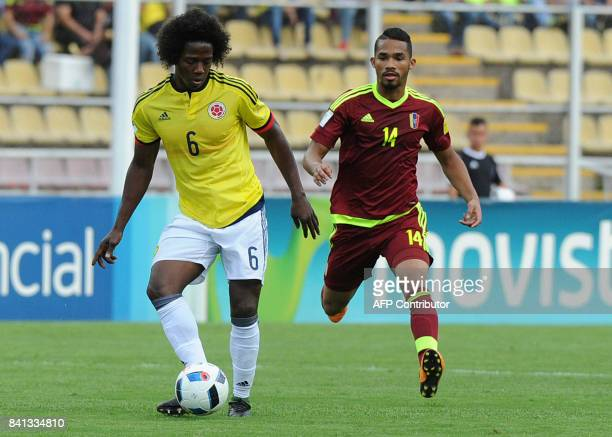 Colombia's Carlos Sanchez and Venezuela's Yangel Herrera vie for the ball during their 2018 World Cup qualifier football match in San Cristobal...