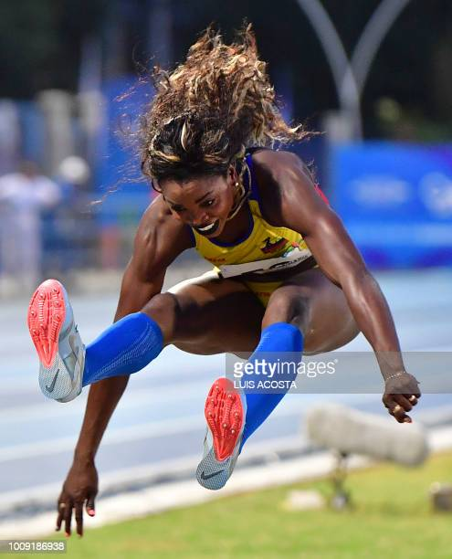 Colombia's Caterine Ibarguen competes in the women's triple jump competition during the 2018 Central American and Caribbean Games in Barranquilla,...
