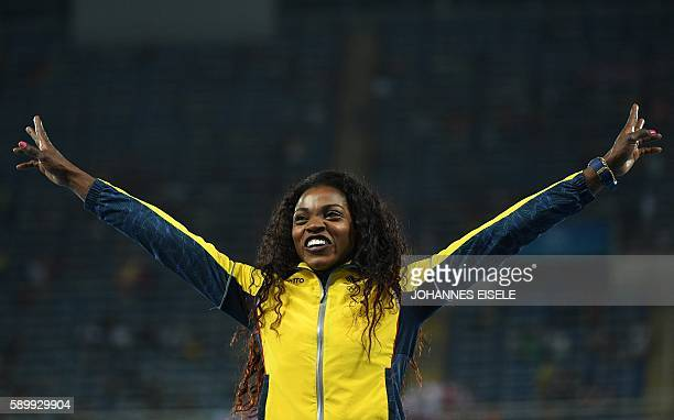 Colombia's Caterine Ibarguen poses during the podium ceremony for the women's Triple Jump during the athletics event at the Rio 2016 Olympic Games at...