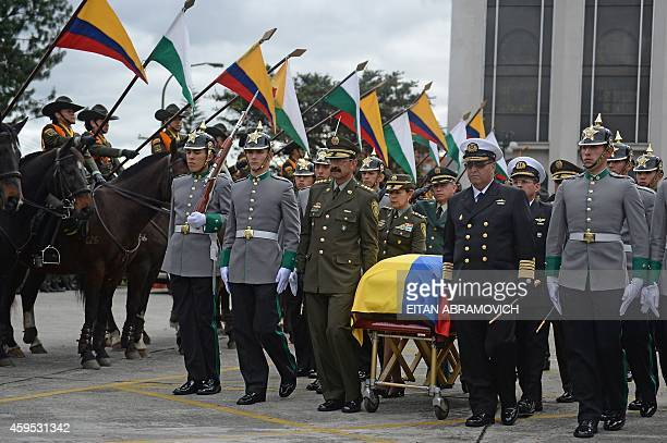 Colombia's Chief of Police General Rodolfo Palomino and Colombian Commander of the Colombian Navy ViceAdmiral Hernando Wills Velez carry a coffin...