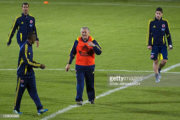 Colombia's coach Eduardo Lara gives instructions to his players during a training session for the FIFA World Cup U20 tournament in Bogota on August 7...