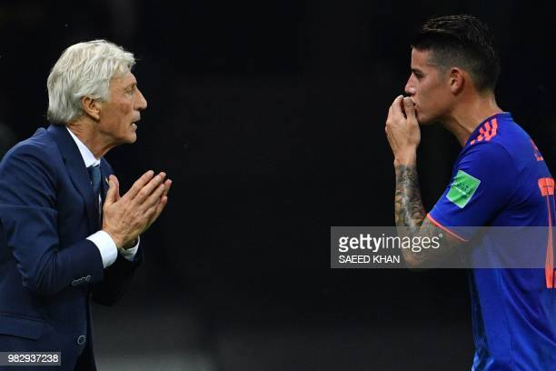 Colombia's coach Jose Pekerman talks to Colombia's midfielder James Rodriguez during the Russia 2018 World Cup Group H football match between Poland...