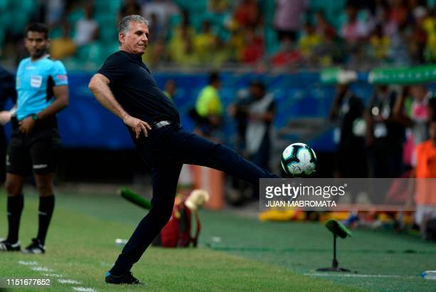 TOPSHOT Colombia's coach Portuguese Carlos Queiroz stretches for the ball during the Copa America football tournament group match against Paraguay at...