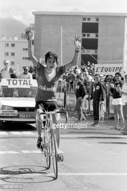 Colombia's cyclist Luis 'Lucho' Herrera celebrates as he crosses the finish line on July 16 1984 after taking part on the 17th stage of the 71st Tour...
