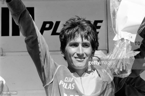 Colombia's cyclist Luis 'Lucho' Herrera celebrates on the podium on July 16 1984 after taking part on the 17th stage of the 71st Tour de France...