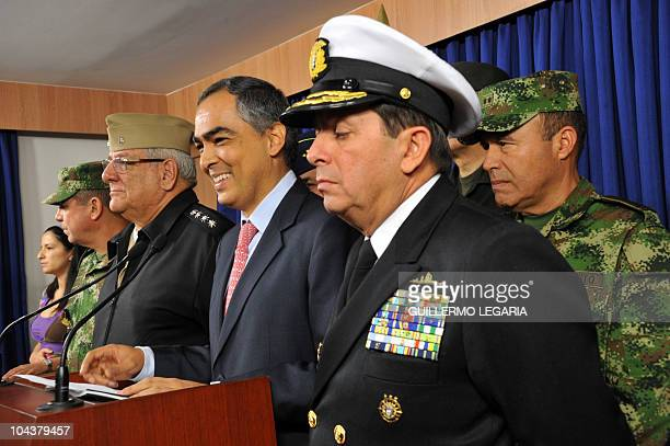 Colombia's Defence Minister Rodrigo Rivera next to Colombia's commander of the Armed Forces Adm Edgar Cely Colombia's Army commander Gen Alejandro...