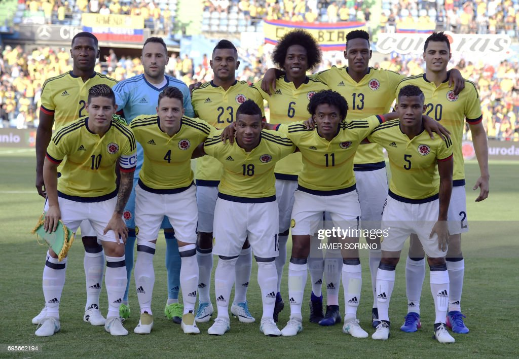 Colombia's defender Cristian Zapata, Colombia's goalkeeper David Ospina, Colombia's forward Miguel Borja, Colombia's midfielder Carlos Sanchez, Colombia's defender Yerri Mina, Colombia's midfielder Gio Moreno (front row L-R) Colombia's midfielder James Rodriguez, Colombia's defender Santiago Arias, Colombia's defender Frank Fabra, Colombia's midfielder Juan Cuadrado and Colombia's midfielder Wilmar Barrios line up before the friendly football match Cameroon vs Colombia at the Col. Alfonso Perez stadium in Getafe on June 13, 2017. /