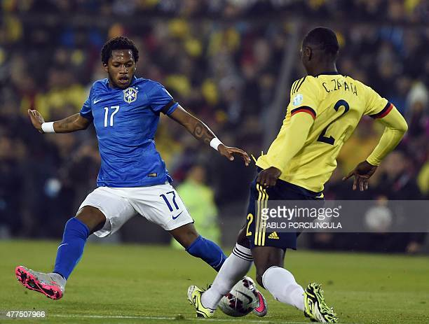 Colombia's defender Cristian Zapata vies for the ball with Brazil's midfielder Fred during their Copa America football match at the Estadio...