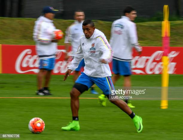 Colombia's defender Farid Diaz runs with the ball during a training session at the Colombian football Federation in Bogota on March 25 2017 ahead of...