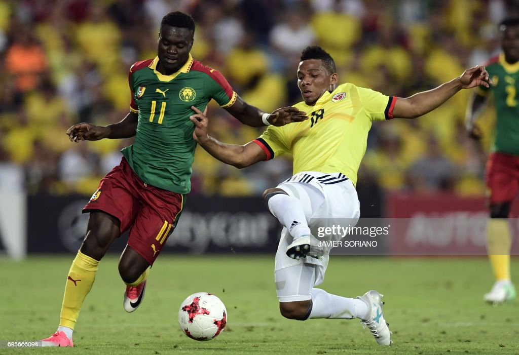 Colombia's defender Frank Fabra (R) vies with Cameroon's forward Olivier Boumal during the friendly football match Cameroon vs Colombia at the Col. Alfonso Perez stadium in Getafe on June 13, 2017. /