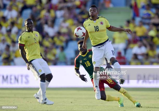 Colombia's defender Frank Fabra vies with Cameroon's midfielder Iambe during the friendly football match Cameroon vs Colombia at the Col Alfonso...