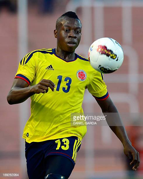Colombia's defender Helibelton Palacios eyes the ball during the South American U-20 Championship Group A football match against Paraguay at Malvinas...