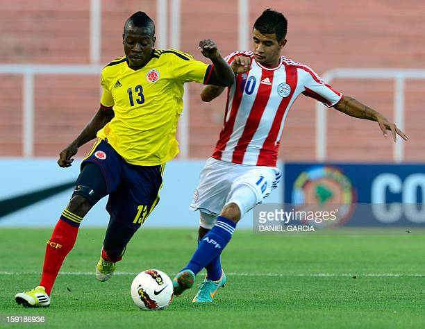 Colombia's defender Helibelton Palacios vies for the ball with Paraguay's forward Derlis Gonzalez, during their South American U-20 Championship...