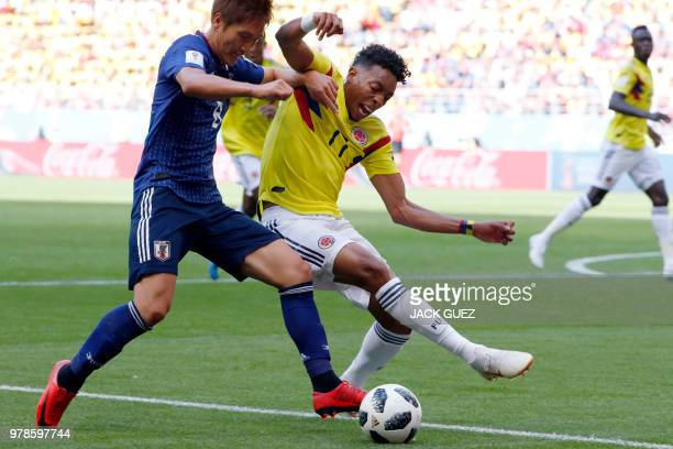 Colombia's defender Johan Mojica challenges Japan's forward Genki Haraguchi during the Russia 2018 World Cup Group H football match between Colombia...