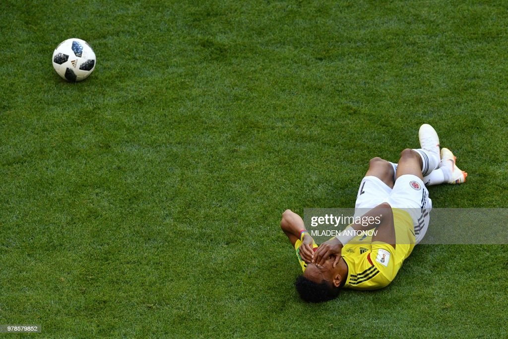 TOPSHOT - Colombia's defender Johan Mojica reacts as he gestures lying on the pitch during the Russia 2018 World Cup Group H football match between Colombia and Japan at the Mordovia Arena in Saransk on June 19, 2018. (Photo by Mladen ANTONOV / AFP) / RESTRICTED