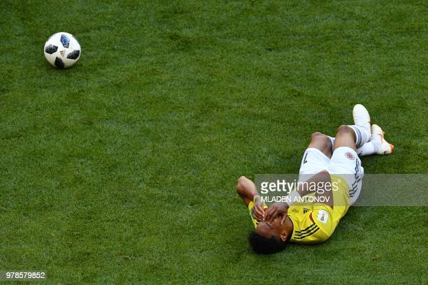 TOPSHOT Colombia's defender Johan Mojica reacts as he gestures lying on the pitch during the Russia 2018 World Cup Group H football match between...