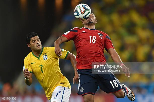 Colombia's defender Juan Camilo Zuniga vies with Brazil's forward Hulk during the quarterfinal football match between Brazil and Colombia at the...