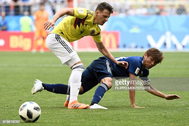 Colombia's defender Santiago Arias challenges Japan's midfielder Takashi Inui during the Russia 2018 World Cup Group H football match between...