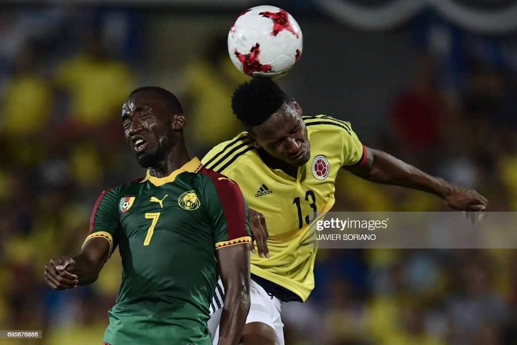 Colombia's defender Yerri Mina (R) vies with Cameroon's forward Nicolas Ngamelu during the friendly football match Cameroon vs Colombia at the Col. Alfonso Perez stadium in Getafe on June 13, 2017. /