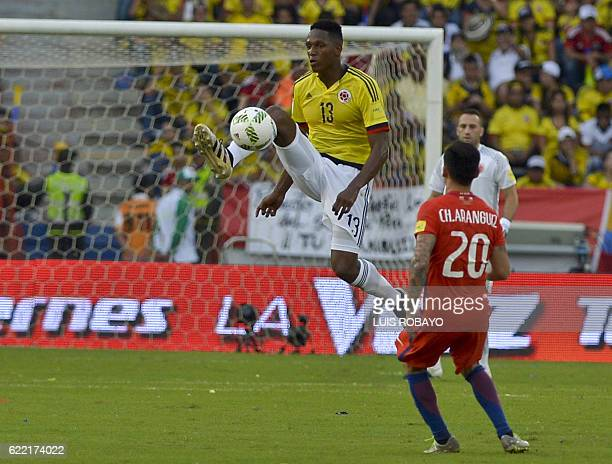 Colombia's defender Yerry Mina and Chile's midfielder Charles Aranguiz vie for the ball during their 2018 FIFA World Cup qualifiers football match in...