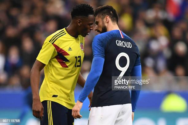 TOPSHOT Colombia's defender Yerry Mina argues with France's forward Olivier Giroud during the friendly football match between France and Colombia at...
