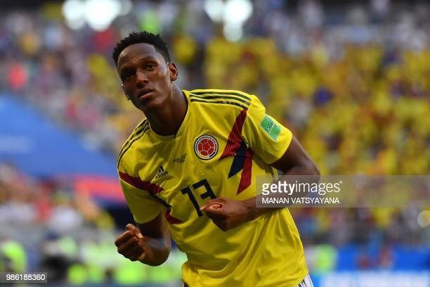 41af4c5e7 Colombia s defender Yerry Mina celebrates after scoring a goal during the  Russia 2018 World Cup Group