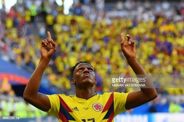 1459ca88f TOPSHOT Colombia s defender Yerry Mina celebrates after scoring a goal  during the Russia 2018 World Cup