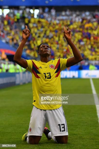 Colombia's defender Yerry Mina celebrates after scoring a goal during the Russia 2018 World Cup Group H football match between Senegal and Colombia...