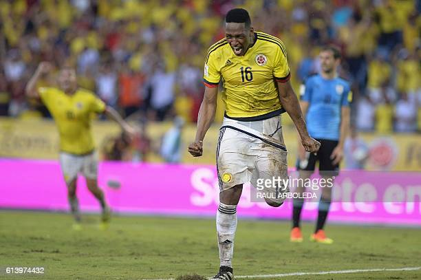 Colombia's defender Yerry Mina celebrates after scoring against Uruguay during their Russia 2018 World Cup qualifier football match in Barranquilla...