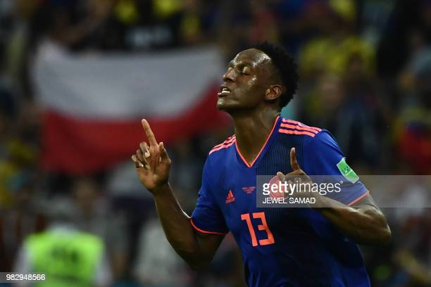 Colombia's defender Yerry Mina celebrates after scoring during the Russia 2018 World Cup Group H football match between Poland and Colombia at the...