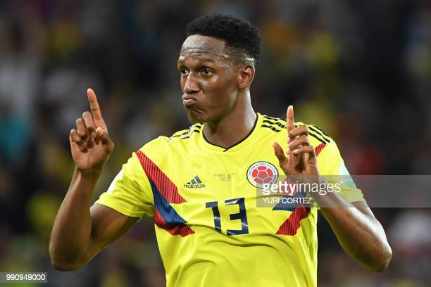 TOPSHOT Colombia's defender Yerry Mina celebrates after scoring the equalizer during the Russia 2018 World Cup round of 16 football match between...