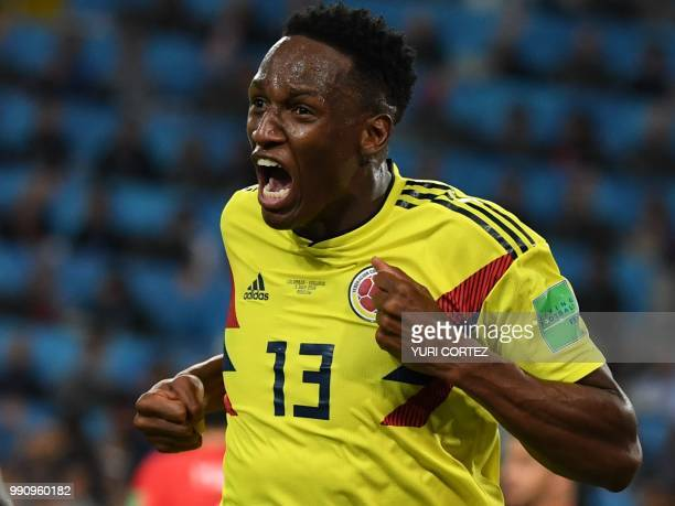Colombia's defender Yerry Mina celebrates after scoring the equalizer during the Russia 2018 World Cup round of 16 football match between Colombia...