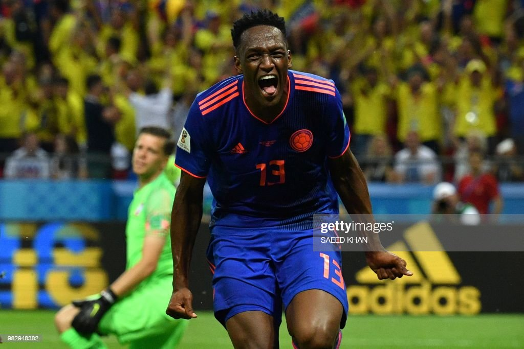TOPSHOT - Colombia's defender Yerry Mina celebrates after scoring the opener during the Russia 2018 World Cup Group H football match between Poland and Colombia at the Kazan Arena in Kazan on June 24, 2018. (Photo by SAEED KHAN / AFP) / RESTRICTED
