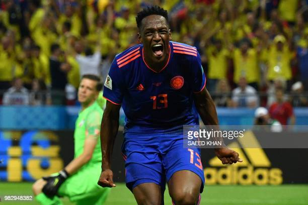 TOPSHOT Colombia's defender Yerry Mina celebrates after scoring the opener during the Russia 2018 World Cup Group H football match between Poland and...