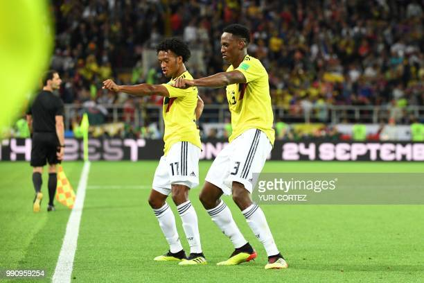 TOPSHOT Colombia's defender Yerry Mina celebrates with Colombia's forward Juan Cuadrado after scoring the equalizer during the Russia 2018 World Cup...